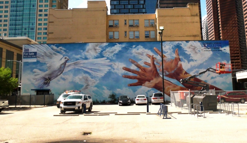 This mural, titled Giving Wings to the Dream, is slated to be replaced with a Black Lives Matter mural, which has sparked some controversy.
