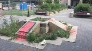 One of the vandalized Frank Oliver plaques has been removed. Tuesday, Aug. 11, 2020 (CTV News Edmonton)