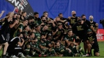 Portland Timbers players pose for photos after defeating Orlando City 2-1, during an MLS soccer tournament, Tuesday, Aug. 11, 2020, in Kissimmee, Fla. (AP Photo/John Raoux)