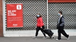 In this Tuesday, June 30, 2020 file photo, members of the public walk past a closed shop in Leicester city centre, England. (AP Photo/Rui Vieira, File)