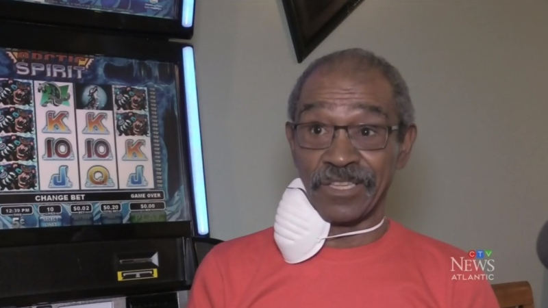 Mike Paris alleges a dispute over a video lottery terminal that resulted in him being handcuffed in the back of a police car is a textbook example of the kind of racism Black people face every day.