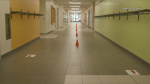 Directional arrows and physical distancing pylons in the hallway of an Ottawa-Carleton District School Board school. (Image courtesy: OCDSB)
