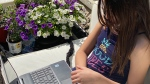 Rachel Kilgour, 10, of Ottawa uses a laptop in a handout photo. Her mother Megan Kilgour is planning to homeschool this September because she's unhappy with Ontario's back to school plan. THE CANADIAN PRESS/HO-Megan Kilgour MANDATORY CREDIT