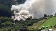 Smoke billows from derailed train in Scotland