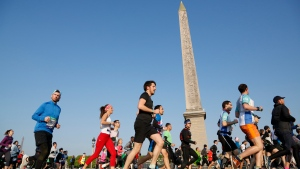 In this Sunday, April 14, 2019 file photo, competitors in the Paris Marathon run past the Cleopatra's Needle at the Place de la Concorde in Paris, France. The Paris Marathon has been canceled because of the coronavirus after repeated attempts to find a new date, organizers said Wednesday, Aug. 12, 2020. The race was originally due to take place in April but was then moved to October. Organizers said they'd recently tried to rearrange the race for November but continuing travel restrictions made that unrealistic. (AP Photo/Thibault Camus, File)