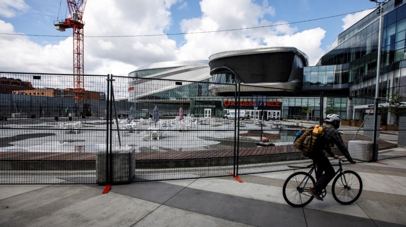 Fencing goes up around the Ice District to create a safe bubble for players, during the upcoming return of NHL hockey in Edmonton, on Thursday, July 23, 2020. THE CANADIAN PRESS/Jason Franson