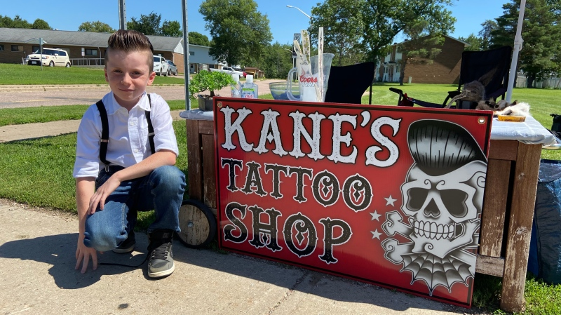 Kane Dempsey, 8, started a removable tattoo stand outside his home in Petawawa, Ont. to raise money for the local SPCA. (Dylan Dyson / CTV News Ottawa)