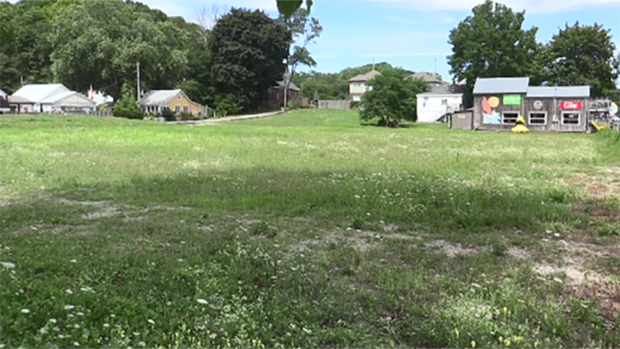 A vacant lot in Port Stanley, Ont. is seen Wednesday, Aug. 12, 2020. It is set to become a pair of five-storey condominiums. (Brent Lale / CTV News)