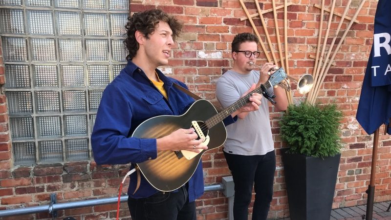 Artists perform at The Parlour Italian Kitchen & Bar patio in downtown Edmonton on Aug. 12, 2020. (CTV News Edmonton)