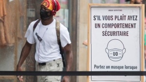 A sign notifying people to wear face masks is shown outside a store in Montreal, Sunday, August 9, 2020, as the COVID-19 pandemic continues in Canada and around the world. THE CANADIAN PRESS/Graham Hughes