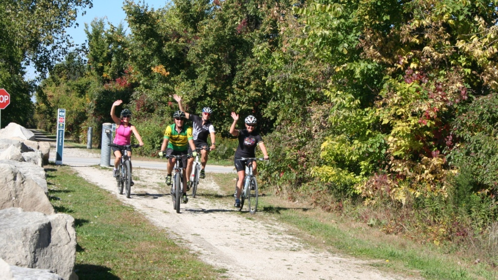 Cyclists travel along Greenway Trails