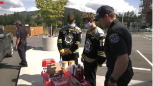 Langford firefighters and members of the Victoria Grizzlies are seen fundraising for the Tim Hortons Children's Foundation in Langford: (CTV News)
