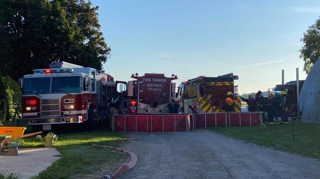 Crews work at the scene of a barn fire near Blyth, Ont. on Wednesday, Aug. 12, 2020. (Source: Gillian Egli)