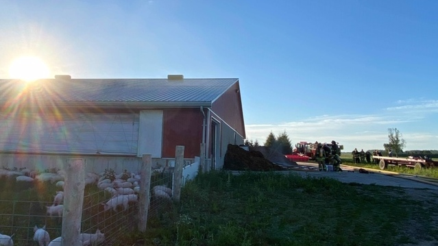 Crews work at the scene of a barn fire near Blyth, Ont. on Wednesday, Aug. 12, 2020. (Source: Gillian Egli)