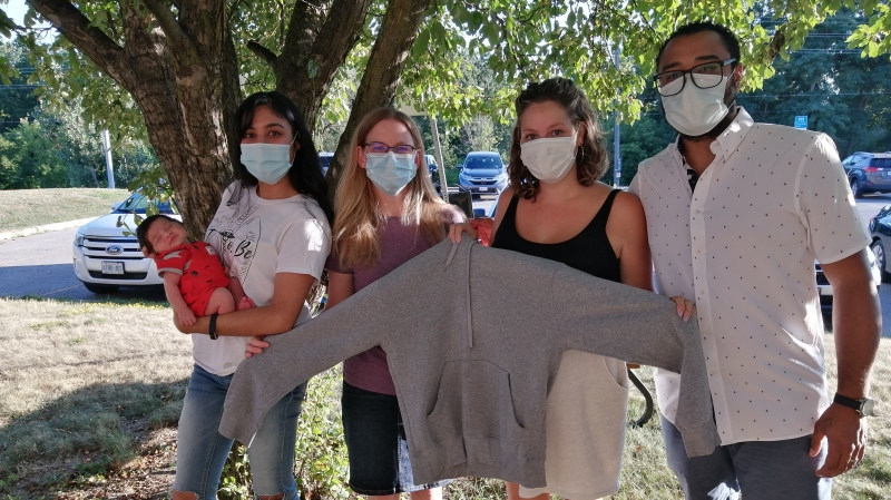 L-R Baby Elias, Pryanka Balley, Caroline Greason, Jessica and Rodrigo Silva.  Jessica and Caroline are holding the sweater that Pryanka gave up for the baby to be wrapped in upon his birth. Aug. 12, 2020. (Stevenson Memorial Hospital, Alliston, Ont.)