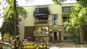 Utility crew saves woman from burning building