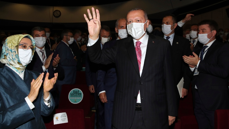 Turkey's President Recep Tayyip Erdogan arrives to address his party members, in Ankara, Turkey, Thursday, Aug. 13, 2020. (Turkish Presidency via AP, Pool)