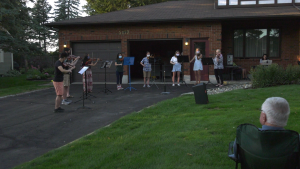 Musicians played a concert in the front yard of Elaine Klimasko, a founding member of the NAC Orchestra. (Shaun Vardon/CTV News Ottawa)