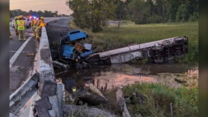 The OPP says a load of liquid tar spilled into a wetland after a crash on Hwy. 401 near Kingston. (Photo courtesy: Twitter/OPP_ER)