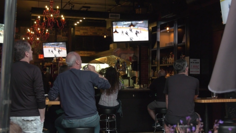 Canucks fans watch the team's first playoff game since 2015 on Aug. 12, 2020.