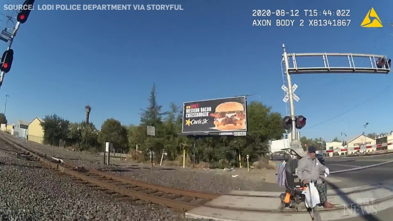 Man in wheelchair saved from oncoming train