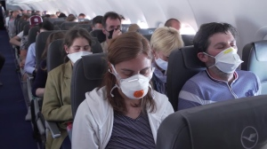Mask wearing is becoming the new normal of air travel. (Credit: CNN)