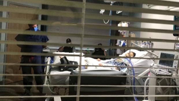 Sacha Bond seen in his hospital bed (Photo courtesy of Bond's family)