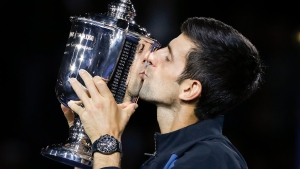 In this Sept. 9, 2018, file photo, Novak Djokovic, of Serbia, kisses the trophy after defeating Juan Martin del Potro, of Argentina, in the men's final of the U.S. Open tennis tournament, in New York. (AP Photo/Adam Hunger, File)