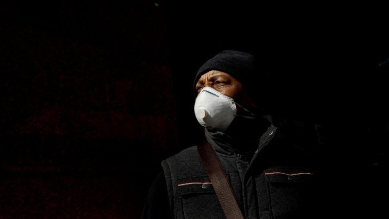 George Mutabazi wears a mask to protect from COVID-19 during the ongoing world pandemic, in Edmonton Alta, on Wednesday April 8, 2020. THE CANADIAN PRESS/Jason Franson​