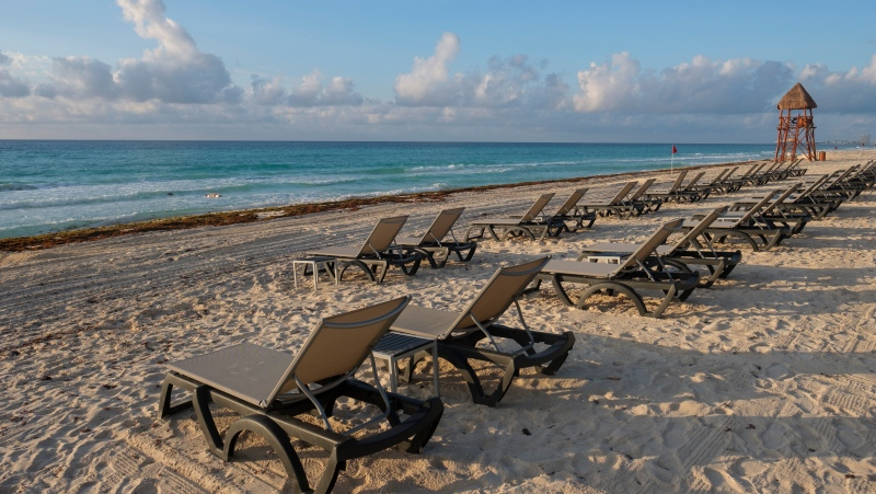 Lounge chairs fill an empty beach in Cancun, Mexico, Thursday, June 11, 2020. (AP Photo/Victor Ruiz)