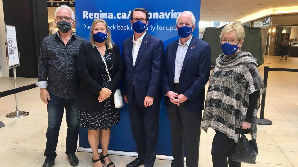 City of Regina Mayor Michael Fougere and city councillors pose for a photo in support of mask use. (Gareth Dillistone / CTV News Regina)