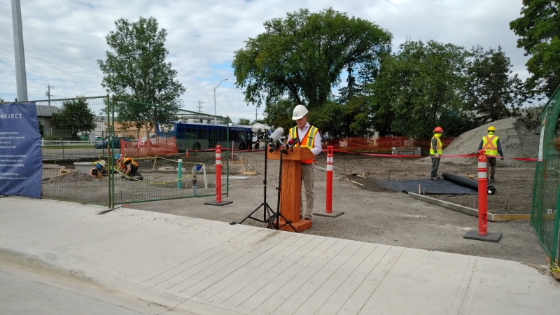 Jason Meliefste, acting deputy city manager of integrated infrastructure services, delivers a mid-season construction update on Aug. 13 in Butler Memorial Park, where underground utilities have been installed and park features, like lights, play spaces and landscaping, are expected to be finished by the end of 2020.