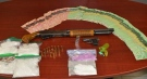 Drugs, weapons and cash seized on Wednesday, Aug. 12, 2020 are seen in this image released by the Chatham-Kent Police Service.