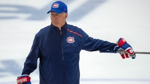 Montreal Canadiens head coach Claude Julien gives instructions during NHL hockey practice in Brossard, Quebec, Tuesday, July 14, 2020. Canadiens general manager Marc Bergevin says coach Claude Julien was experiencing chest pains Wednesday, Aug. 12, 2020 and was taken by ambulance to a Toronto hospital. Bergevin confirmed it was not COVID-19 related. The 60-year-old coach is not expected to be back behind the bench for the rest of the team's first-round series against Philadelphia. Associate coach Kirk Muller will take over Julien's role in an interim basis. (Ryan Remiorz/The Canadian Press via AP)