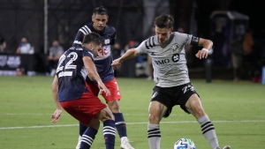 Montreal Impact defender Jukka Raitala, right, battles for the ball with New England Revolution midfielder Carles Gil, left, and midfielder Brandon Bye, center, during the first half of an MLS soccer match, Thursday, July 9, 2020, in Kissimmee, Fla. (THE CANADIAN PRESS/AP/John Raoux)
