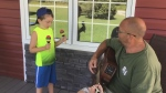 A father and son from Evansville on Manitoulin Island, Jeff Gilmore and Jay Bailey, perform a duet of 'You've Got a Friend in Me.'