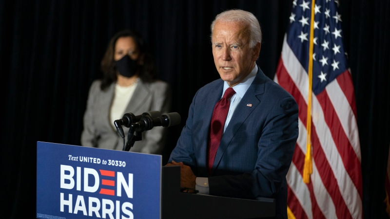 Democratic presidential candidate former Vice President Joe Biden joined by his running mate Sen. Kamala Harris, D-Calif., speaks at the Hotel DuPont in Wilmington, Del., Thursday, Aug. 13, 2020. (AP Photo/Carolyn Kaster)