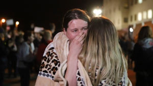 Relatives hug after being released from a detention center where protesters were detained during a mass rally following presidential election in Minsk, Belarus, Friday, Aug. 14, 2020. (AP Photo)