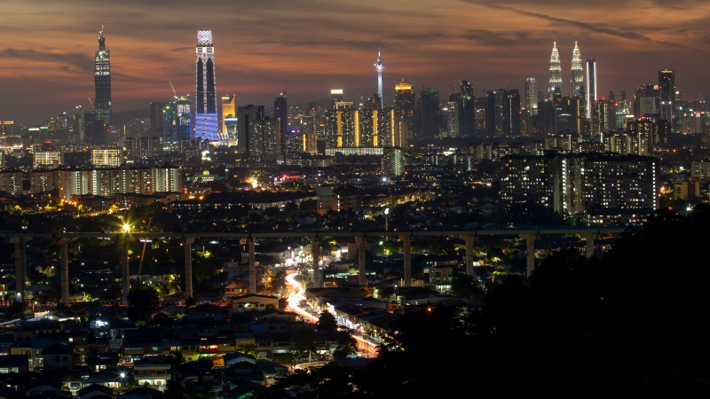 This photo shows a night view of city center in Kuala Lumpur, Malaysia on Aug. 10, 2020. (AP Photo/Vincent Thian)