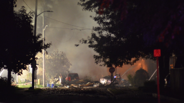View from a distance as emergency crews work on putting out fires caused by the explosion on Woodman Avenue, Aug. 14, 2019. (Source: Joe O'Neil)