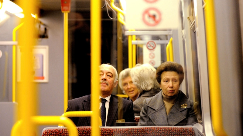 In this March 29, 2020 file photo, Britain's Princess Anne takes a ride on the Newcastle Metro Train in Newcastle, England, after she officially opened the revamped Haymarket Metro Station. (Owen Humphreys/PA via AP)