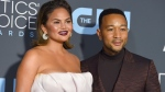 "Chrissy Teigen, left, and John Legend arrive at the 24th annual Critics' Choice Awards on Jan. 13, 2019, in Santa Monica, Calif. It's baby No. 3 for Legend and Teigen. The couple revealed they are expecting in Legend's new video for the song ""Wild,"" which premiered Thursday and features Teigen and Legend holding her baby bump at the end of the clip. (Photo by Jordan Strauss/Invision/AP, File)"