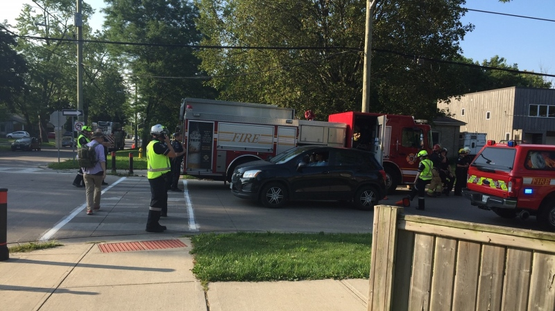 Emergency crew on scene where a vehicle struck a house and severed a gas line in London, Ont. on Friday, Aug. 14, 2020. (Marek Sutherland / CTV News)