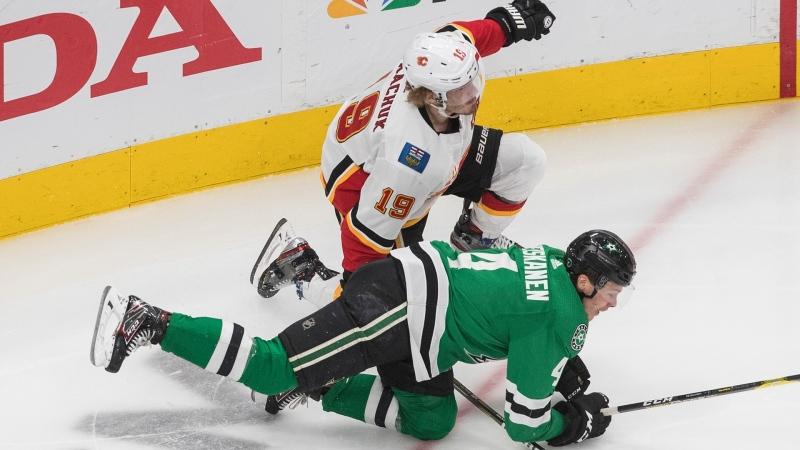 Calgary Flames' Matthew Tkachuk (19) and Dallas Stars' Miro Heiskanen (4) collide during the third period of a first round NHL Stanley Cup playoff hockey series in Edmonton, on Thursday August 13, 2020. THE CANADIAN PRESS/Jason Franson