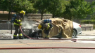 Fire crews work on a vehicle outside the Kitchener courthouse that reportedly exploded. (Dan Lauckner - CTV Kitchener) (Aug. 14, 2020)