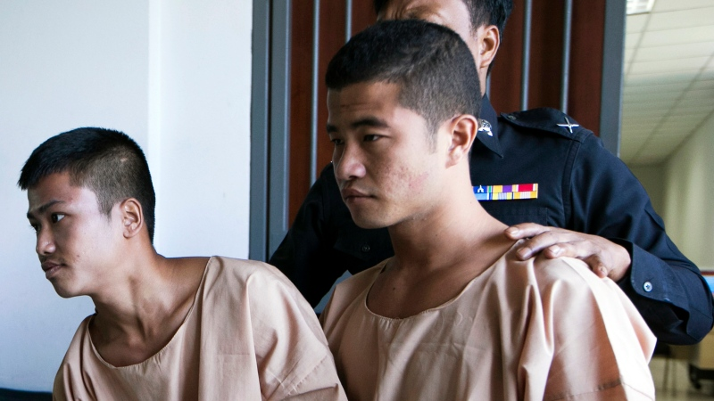 In this Dec. 24, 2015 file photo, Myanmar migrants Win Zaw Htun, right, and Zaw Lin, left, both 22, are escorted by officials after their guilty verdict at court in Koh Samui, Thailand. (AP Photo/Wason Wanichakorn, File)