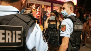 France has mandated mask wearing outside in certain busy streets and market areas. (AFP)