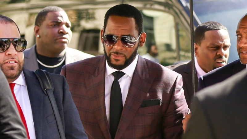 In this June 26, 2019 file photo, R&B singer R. Kelly, center, arrives at the Leighton Criminal Court building for an arraignment on sex-related felonies in Chicago. (AP Photo/Amr Alfiky, File)