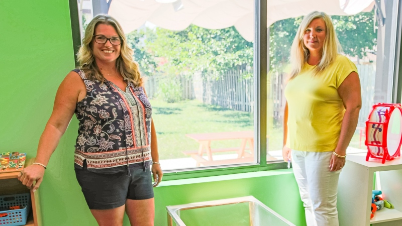 Robin Jones (left) and Lisa Walker (right) are setting up toys in what they call the green room in preparation for more children to attend Kids Connection Daycare in September.