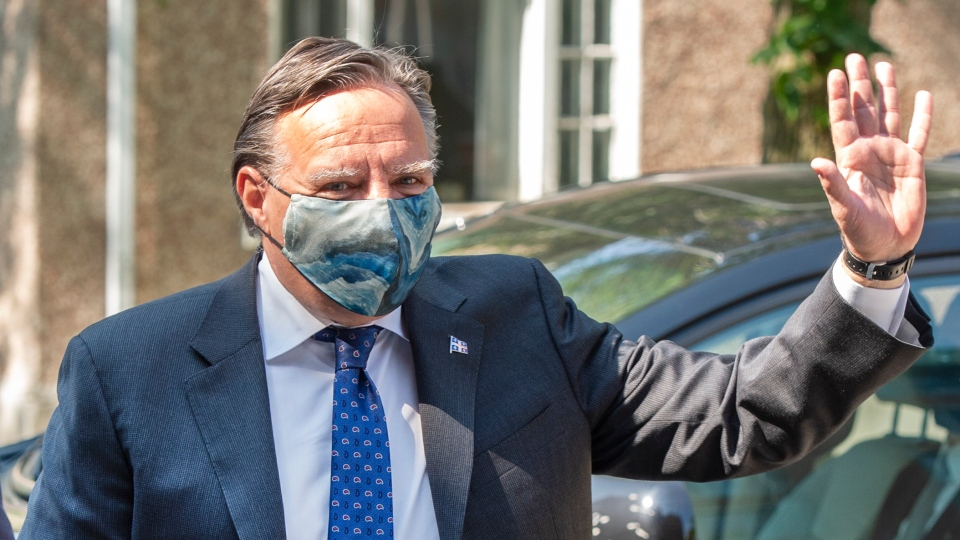 Quebec Premier Francois Legault waves as he arrives for a visit to a CHSLD seniors residence in L'Assomption, Que., Tuesday, Aug. 11, 2020. Legault balked when asked if he would endorse the UN Declaration on the Rights of Indigenous Peoples Friday fearing a veto on economic projects. THE CANADIAN PRESS/Ryan Remiorz